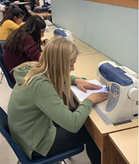 picture of students in class sewing