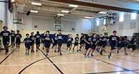 picture of students running pacer in PE class