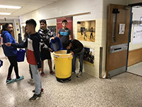 picture of students recycling
