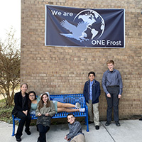 picture of students in front of school