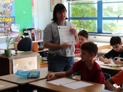 picture of Ms. Perina talking with students